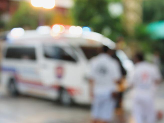 Ambulance responding to an emergency call blurred background
